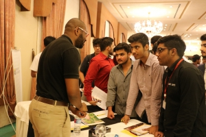 Pakistani students taking turns to speak with a U.S. college representative at the EdUSA College Fair held in Islamabad as part of the 11th South Asia Tour.