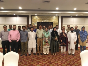 "Alumni in Peshawar enjoy the screening of ""Armed with Faith""."