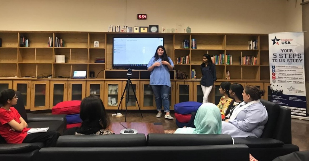 EdUSA's summer interns from Lahore Noor and Tanya, addressing an event they helped organize.