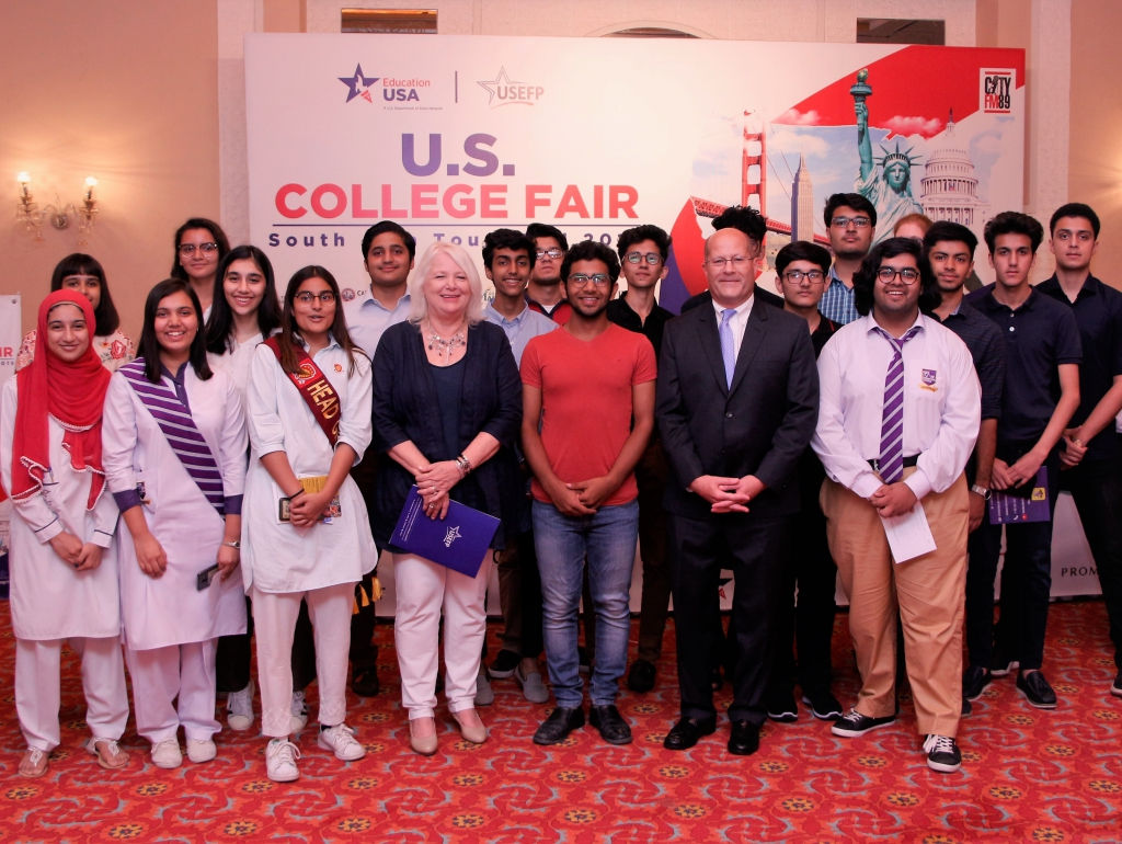 U.S. Embassy Deputy Chief of Mission John Hoover at the College Fair in Islamabad with students of the Opportunity Fund and Competitive College Club