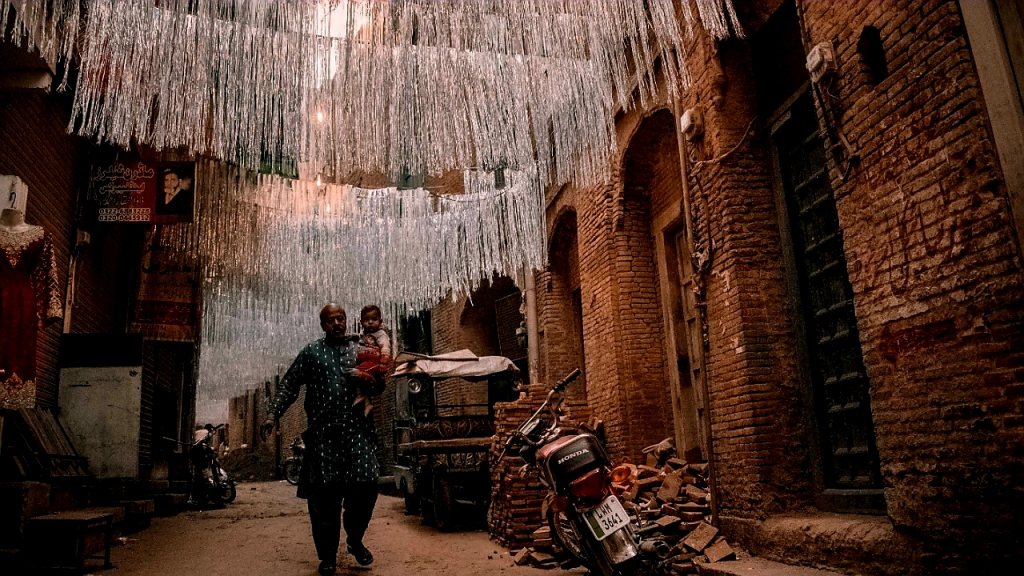The first-prize winner at the photography competition in Lahore