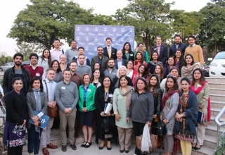 U.S. college representatives with Pakistani high school counselor's academy.