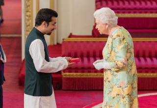 Hassan Mujtaba Zaidi receiving the prestigious Queen's Young Leaders Award from Queen Elizabeth II
