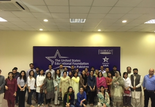 """Alumni in Lahore enjoy the screening of """"Armed with Faith""""."""