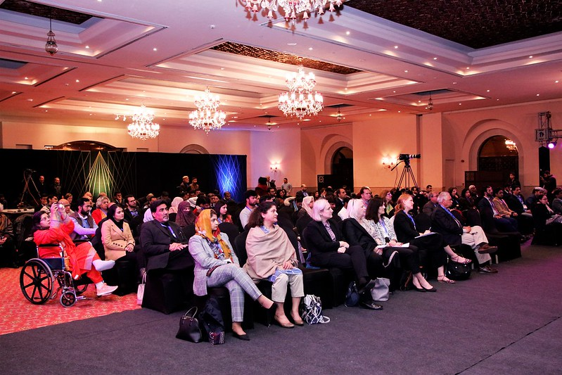 The audience looks on as speakers talk about a variety of topics