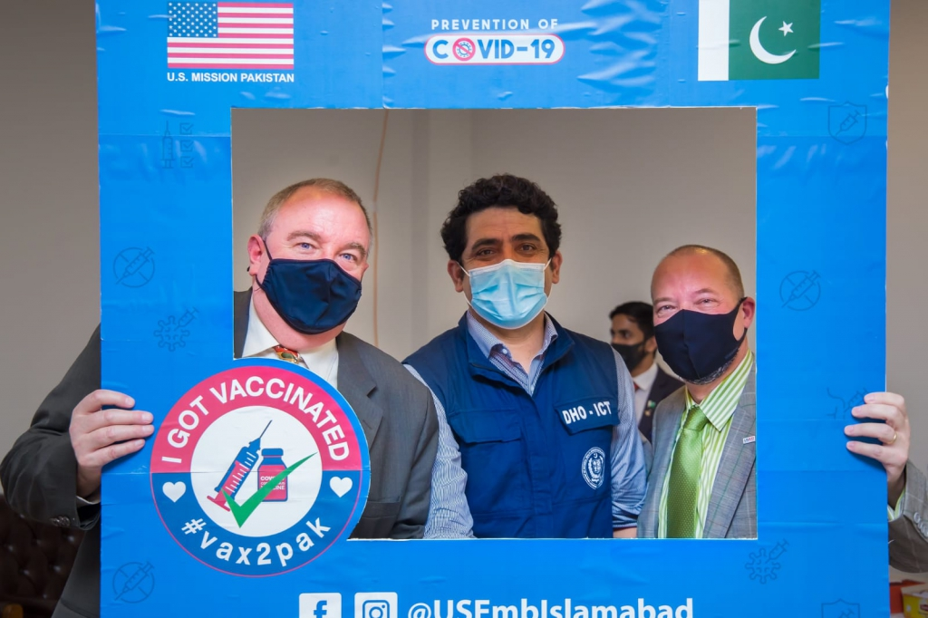 Dr. Zia (center) is working hard to curb Covid-19 in his city.