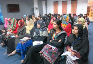 Women listen intently during a GRE orientation session at Islamic International University, Islamabad.