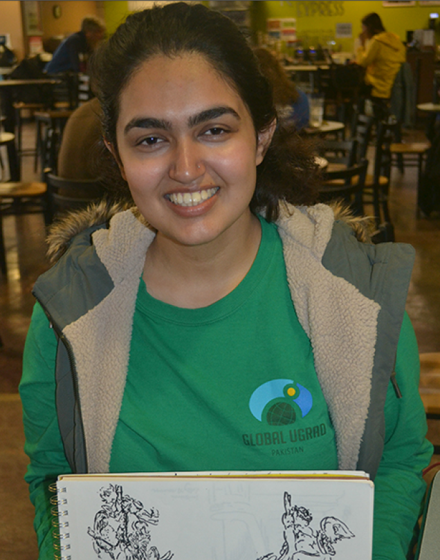 "Muniba Dodhy with her design for University of Kansas School of Business' ""Hawk-a-thon"""