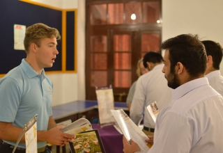 U.S. university reps discussing various stages of the application process with students at the College Fair